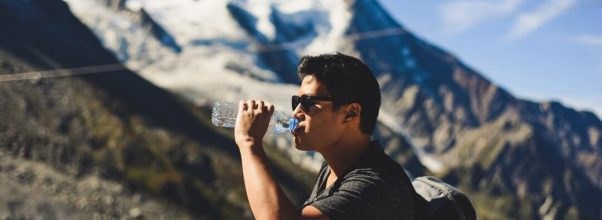 man_hiking_drinking_water